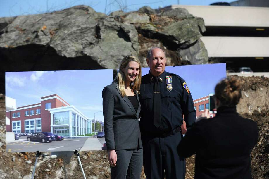 Stamford Police Chief Jon Fontneau, right, poses for a photo with Rep. Caroline Simmons in front of the site of the new station on Bedford St. in Stamford, Conn. on Tuesday, Feb. 28, 2017. Photo: Michael Cummo / Hearst Connecticut Media / Stamford Advocate