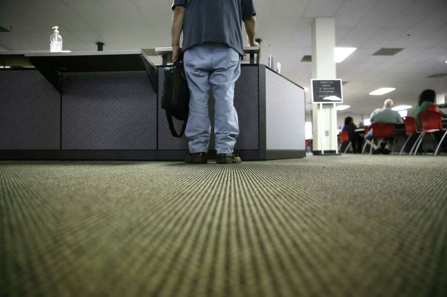 Weekly applications for unemployment aid plunged 25,000 to a seasonally adjusted 234,000, the Labor Department said Thursday. The four-week average, a less volatile measure, dipped to 250,000. Photo: LM Otero /Associated Press / Copyright 2017 The Associated Press. All rights reserved.