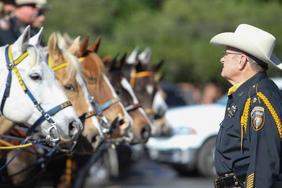 Harris County Sheriff's Honor Guard Maj. D. Hudson talks to member of the Harris County mounted officers at the funeral for Harris County Pct. 3 Assistant Chief Deputy Constable Clinton Greenwood Thursday, April 6,2017.