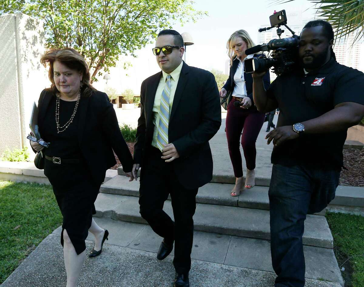 San Antonio Police Officer Robert Encina leaves the John Wood Federal Courthouse on Thursday, Apr. 6, 2017 after a federal jury found him not guilty in a civil case for the February 2014 shooting of Marquise Jones. Walking beside Encina was City Assistant Attorney Debbie Klein.