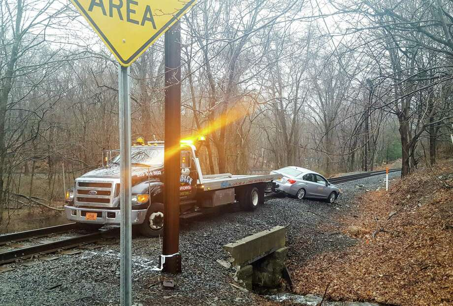 The Danbury Branch of the Metro-North Railroad is experiencing delays from Wilton to Branchville after a one-car crash led to a car getting stuck at the Mather Road grade crossing in Wilton, police said. Photo: Thane Grauel / Hearst Connecticut Media