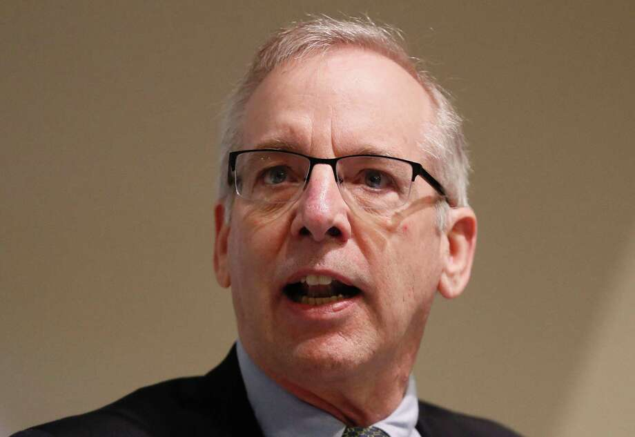 Federal Reserve Bank of San Francisco President John Williams says Fed officials probably would go slower on raising its interest rate and reducing the size of its asset holdings than would be the case if it was just moving on one of the two. Photo: Kirsty Wigglesworth /AFP /Getty Images / AFP