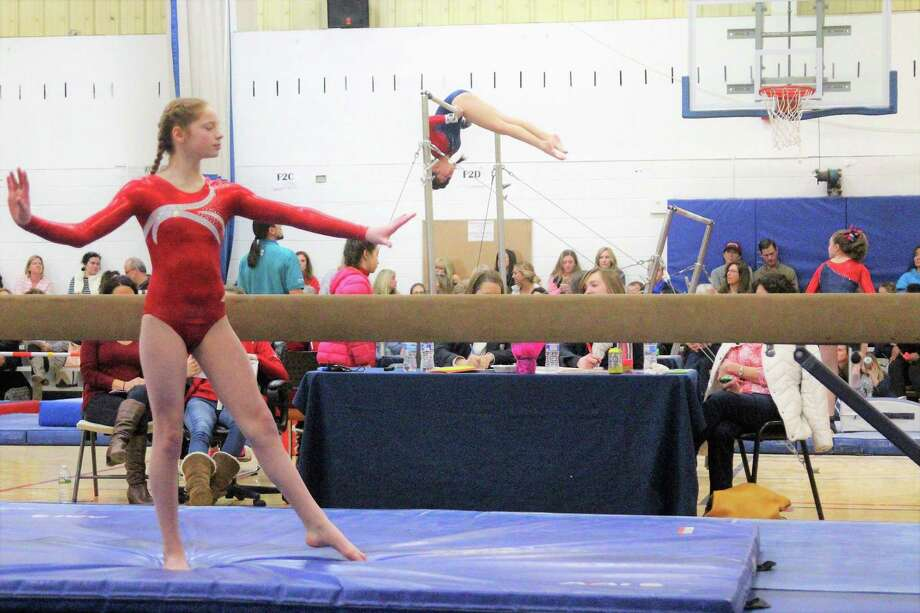 Alyson Scheurkogel of the Wilton Y Gymnastics team competes at Level 5, on beam during the recent Connecticut State Championship Y Meet held in Wilton. Photo: Contributed Photo / Hearst Connecticut Media / Norwalk Hour