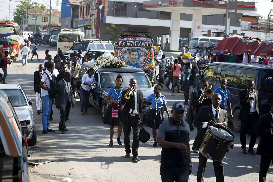 Musicians play during a funeral in the capital, Port-au-Prince, Haiti. In a nation where two out of three people live on less than $2 per day, burying the dead is a predatory business. Photo: Dieu Nalio Chery, Associated Press