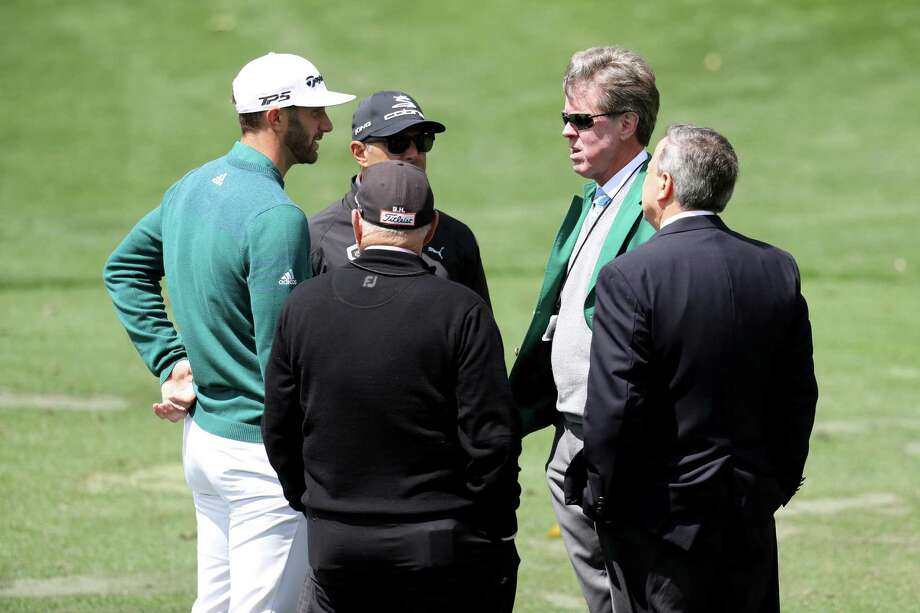AUGUSTA, GA - APRIL 06:  Dustin Johnson (L) of the United States talks to Augusta National member Fred Ridley (2nd R) on the practice range prior to announcing his withdrawl during the first round of the 2017 Masters Tournament at Augusta National Golf Club on April 6, 2017 in Augusta, Georgia. Photo: Rob Carr, Getty Images / 2017 Getty Images