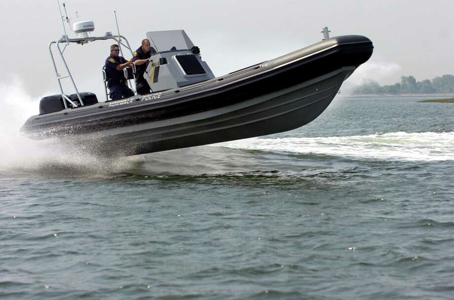 Norwalk_052507_Norwalk police officers Gregg cq Scully cq, left, and John Taranto cq test the department's new high-performance rigid hull inflatabale boat. The police purchased the boat with a grant from the Department of Homeland Security. Andrew Sullivan/Staff photo Staff Photo Andrew Sullivan Photo: ANDREW SULLIVAN / ST / 00003238A