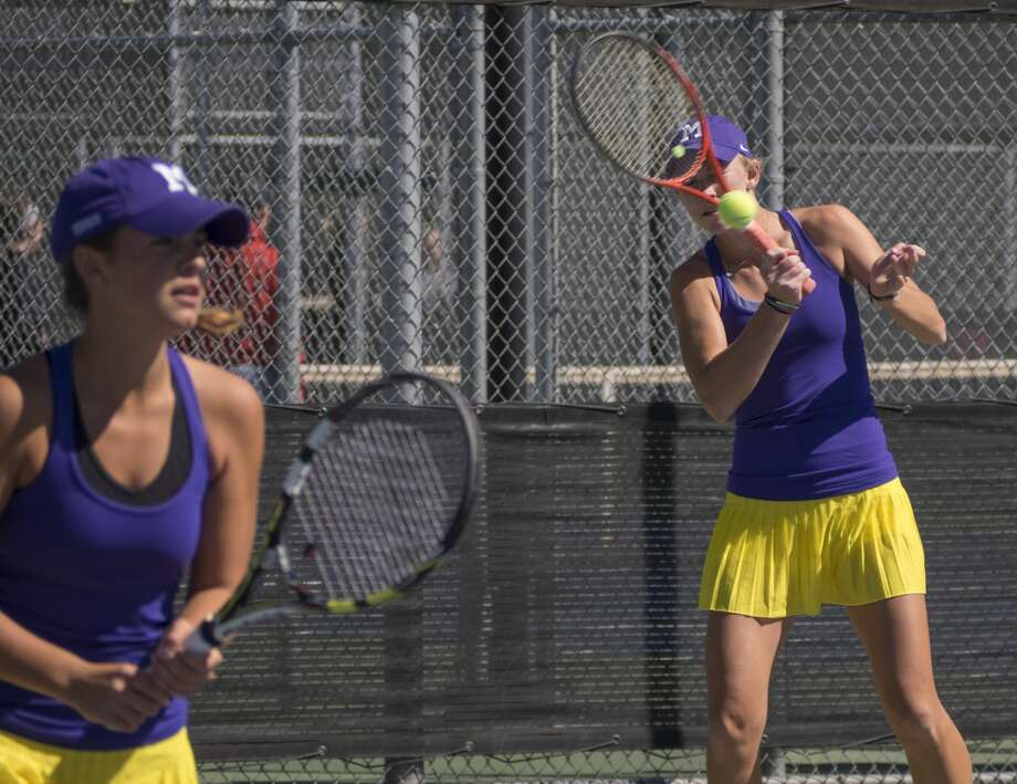 Midland High's Kate Daugherty returns a shot with doubles partner Allison Stewart 04-06-17 during the first day of District 2-6A tournament action.  Tim Fischer/Reporter-Telegram Photo: Tim Fischer/Midland Reporter-Telegram