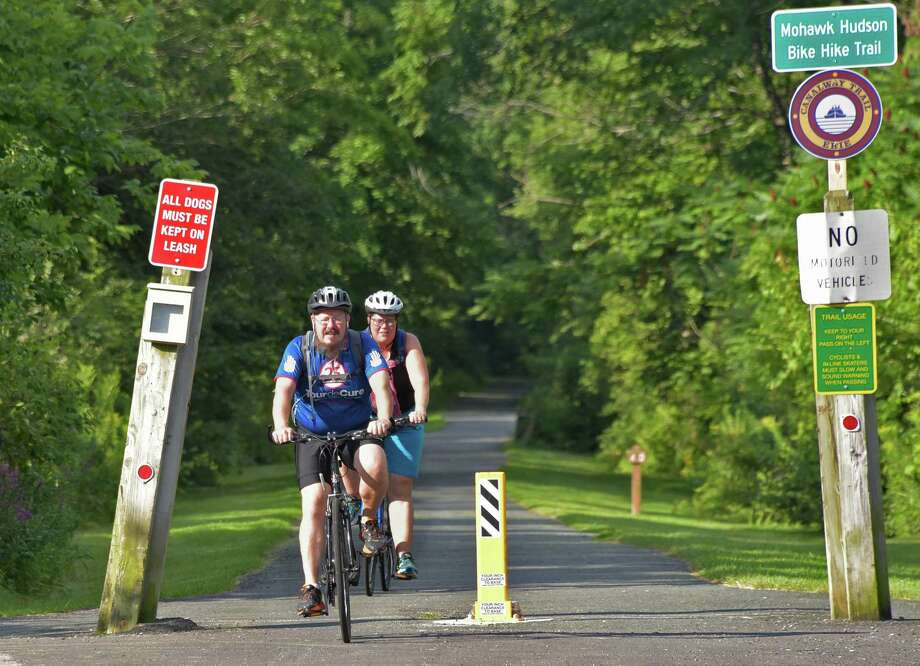 Jeff Cutler, left, and Sandy Kershaw, both of Cohoes, get their ride in early to beat the heat along the Mohawk Hudson Bike Hike Trail Friday Aug. 12, 2016 in Colonie, NY.(John Carl D'Annibale / Times Union) Photo: John Carl D'Annibale