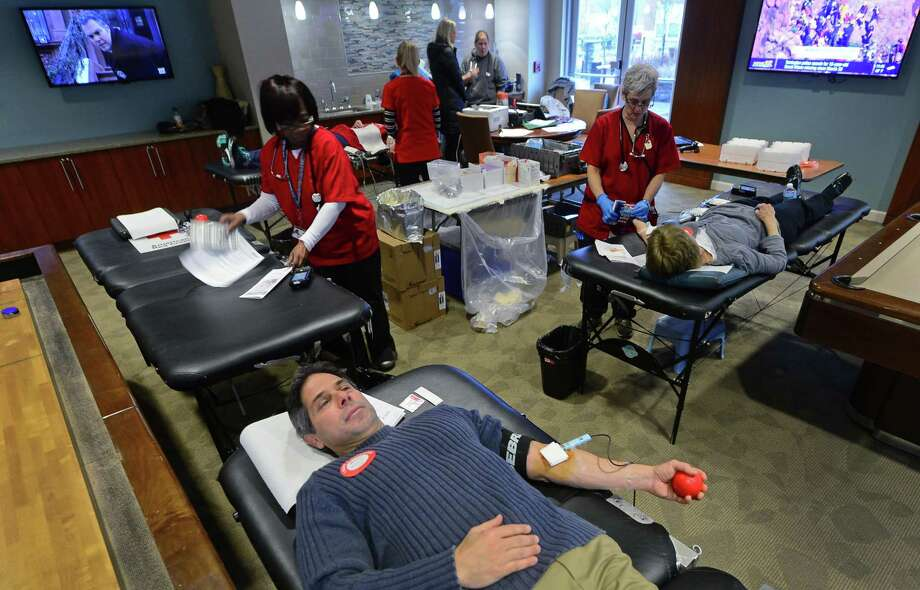 Weston resident Mark McCall gives blood during the American Red Cross Blood Drive Thursday, April 6, 2017, at Avalon Apartments, 8 Norden Place, in Norwalk, Conn.  Photo: Erik Trautmann, Hearst Connecticut Media / Norwalk Hour