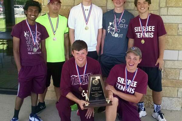 The Silsbee boy's tennis team celebrates after winning the District 22-4A meet in Beaumont. Standing (from left), Brian Mohabir, Jamie Mather, Jacob Fisher, Dylan Wilson and Ben Adams. Kneeling (from left) Rex Martinez and Reece Smithhart. (Photo provided by Silsbee ISD)