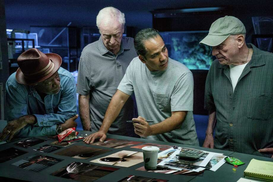 """In this image released by Warner Bros. Pictures, Morgan Freeman, from left, Michael Caine, John Ortiz and Alan Arkin appear in a scene from """"Going in Style."""" (Atsushi Nishijima/Warner Bros. Pictures via AP) ORG XMIT: NYET148 Photo: Atsushi Nishijima / ©2015 Warner Bros. Entertainment Inc. and RatPac-Dune Entertainm"""