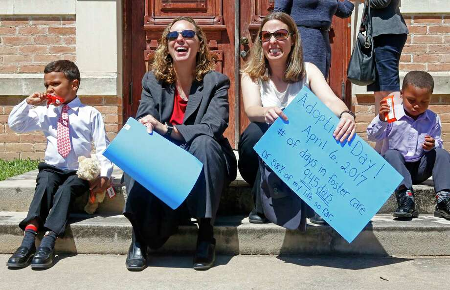 Angela Sugarek and Carol Jeffery celebrate the adoption of their two sons at the Wharton County courthouse, Thursday, April 6, 2017.  (Annie Mulligan / Freelance) Photo: Annie Mulligan / For The Houston Chronicle / @ 2017 Annie Mulligan & the Houston Chronicle