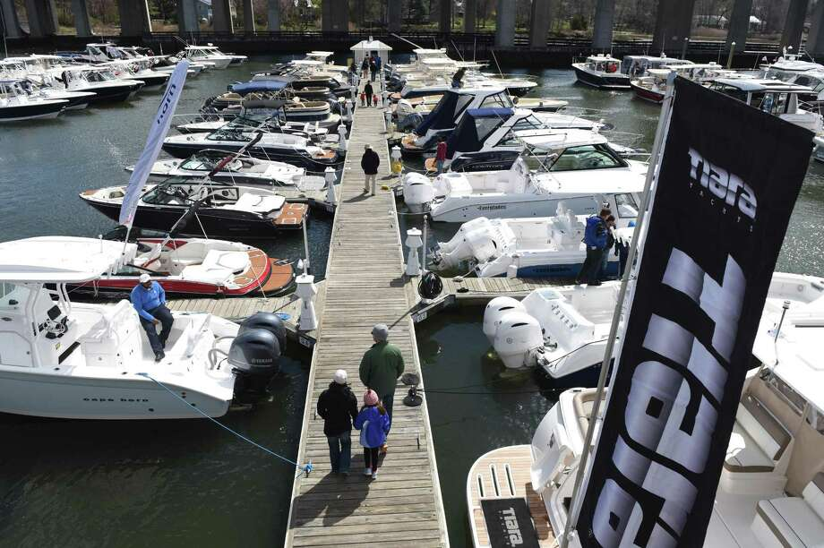 People browse at the Greenwich Boat Show at the Greenwich Water Club in Greenwich, Conn. Sunday, April 3, 2016. The free two-day event featured a selection of new boats from 19 dealers, representing 43 different manufacturers, including a variety of luxury boats, pontoon boats, fishing boats, family boats and more. Photo: Tyler Sizemore / Hearst Connecticut Media / Greenwich Time