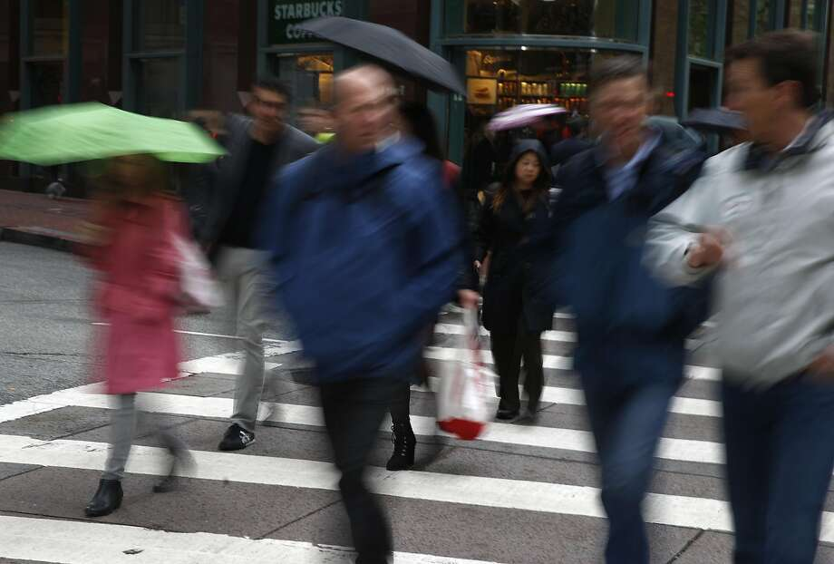 Office workers stroll along Market Street to their jobs Thursday during Walk to Work Day. Photo: Paul Chinn, The Chronicle