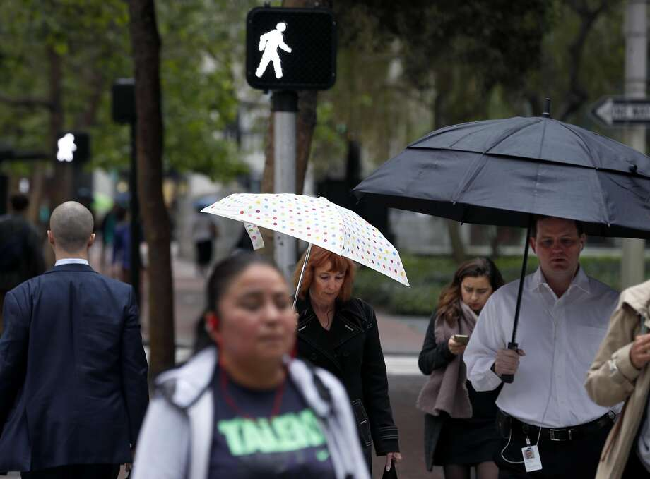 Office workers stroll to their jobs on Market Street in the Financial District during Walk to Work Day. Photo: Paul Chinn, The Chronicle
