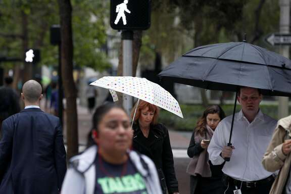 Office workers walk to their jobs on Market Street in the Financial District in San Francisco, Calif. on Thursday, April 6, 2017. Thursday was recognized as Walk to Work Day.