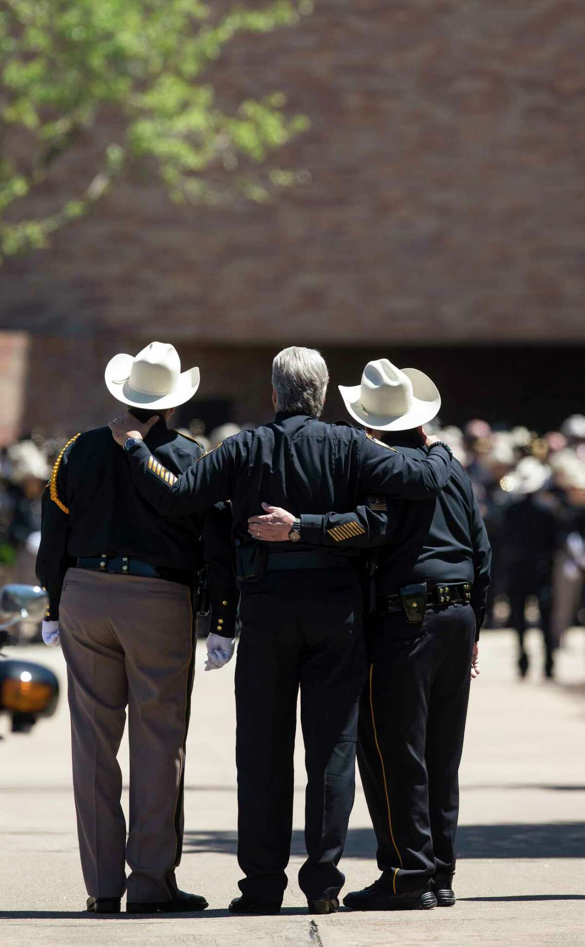 Law enforcement officers embrace during the funeral of Harris County Precinct 3 Assistant Chief Deputy Clinton Greenwood at Second Baptist Church Thursday, April 6, 2017, in Houston.
