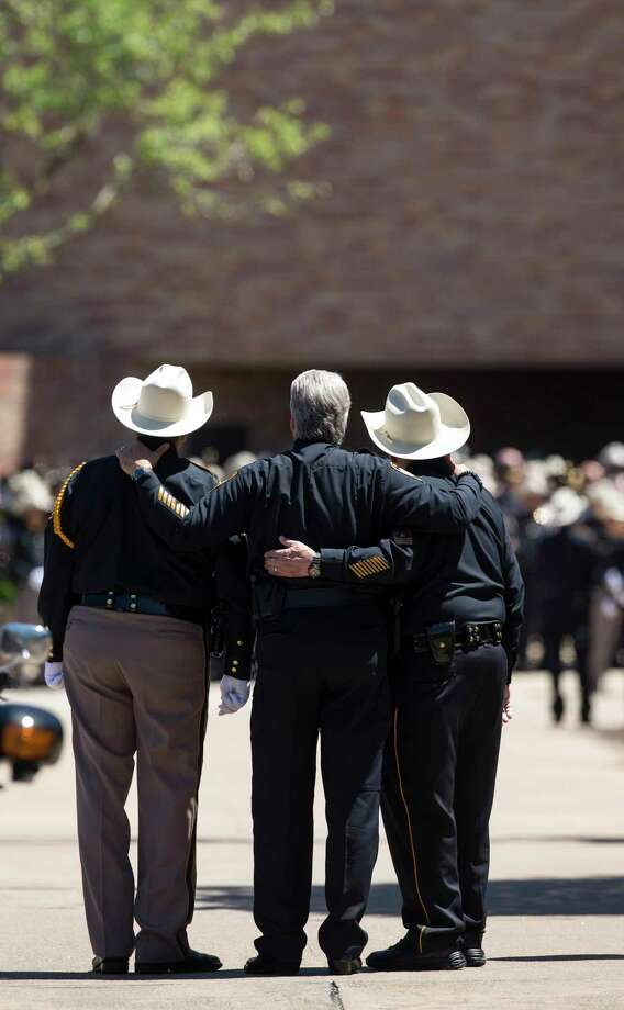 Law enforcement officers embrace during the funeral of Harris County Precinct 3 Assistant Chief Deputy Clinton Greenwood at Second Baptist Church Thursday, April 6, 2017, in Houston. Photo: Godofredo A. Vasquez, Houston Chronicle / Godofredo A. Vasquez