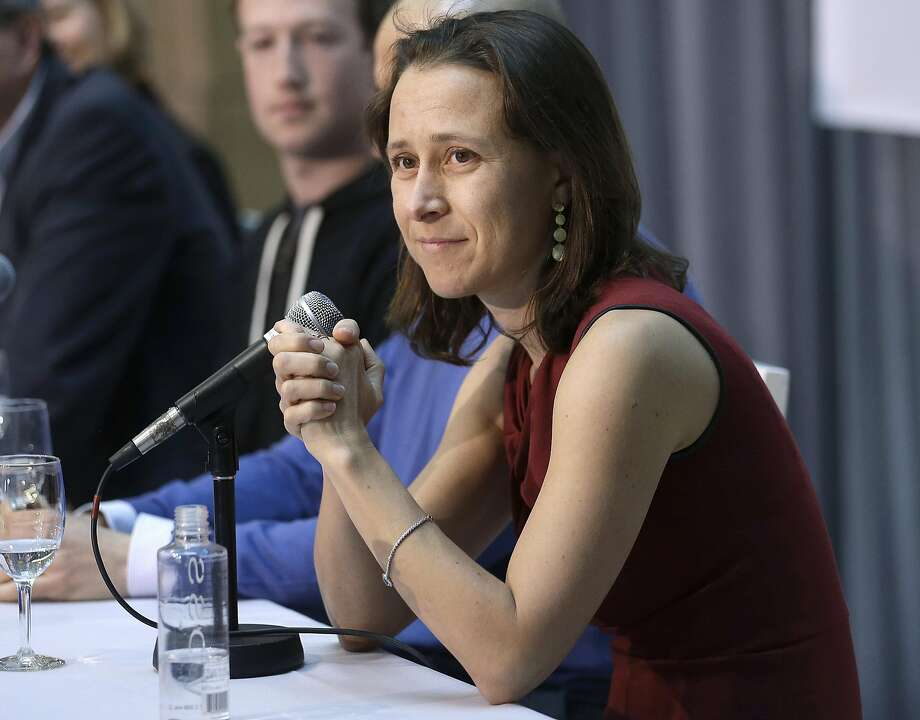23andMe co-founder and CEO Anne Wojcicki speaks at UCSF's Mission Bay campus in San Francisco in 2013. The privately held firm, founded in 2006, says it is the first company to receive authorization from federal regulators to sell, directly to consumers, tests showing personal risk for certain diseases. Photo: Jeff Chiu, Associated Press
