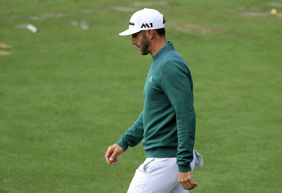 Dustin Johnson of the United States walks to the clubhouse after announcing his withdrawl during the first round of the 2017 Masters Tournament at Augusta National Golf Club on April 6, 2017 in Augusta, Georgia. Photo: Rob Carr, Staff / 2017 Getty Images