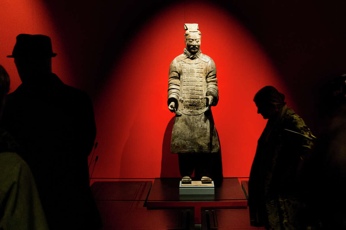 A terra-cotta statue of an armored general greets museum goers during a media tour of the Pacific Science Center's new exhibit, Terracotta Warriors of the First Emperor, on Thursday, April 6, 2017.