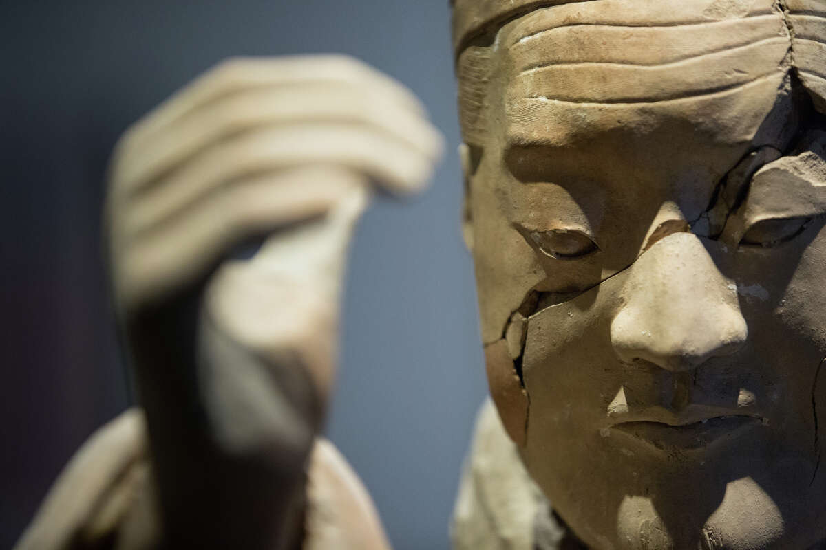A terra-cotta statue of a kneeling musician is seen at Pacific Science Center's new exhibit, Terracotta Warriors of the First Emperor, on Thursday, April 6, 2017.