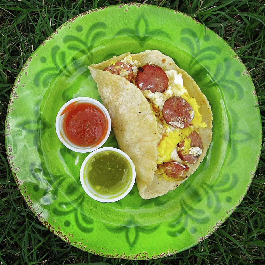 Country sausage and egg taco on a handmade corn tortilla from Las Velas on South Loop 1604 East. Photo: Mike Sutter /San Antonio Express-News
