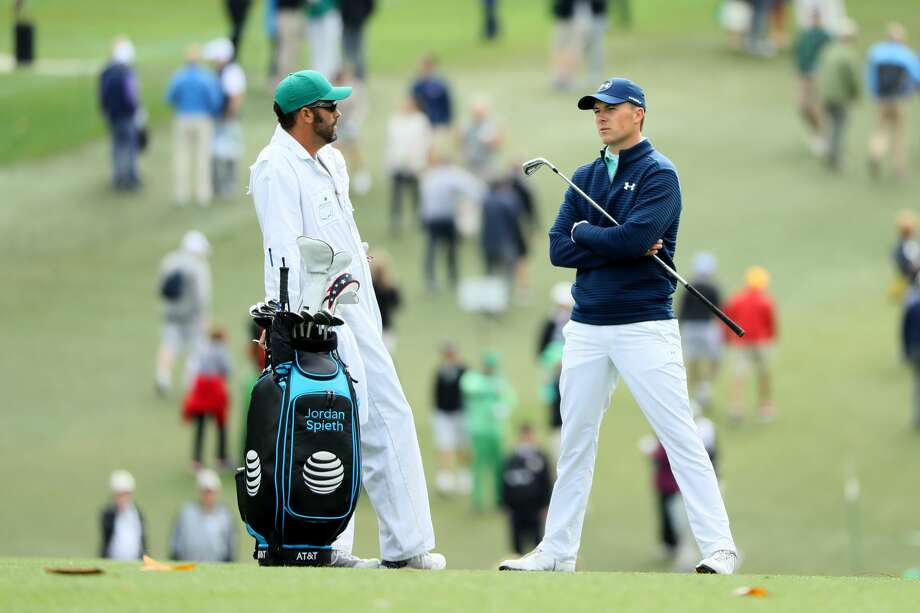 AUGUSTA, GA - APRIL 06:  Jordan Spieth of the United States talks with his caddie Michael Greller on the first hole during the first round of the 2017 Masters Tournament at Augusta National Golf Club on April 6, 2017 in Augusta, Georgia.  (Photo by Andrew Redington/Getty Images) Photo: Andrew Redington/Getty Images