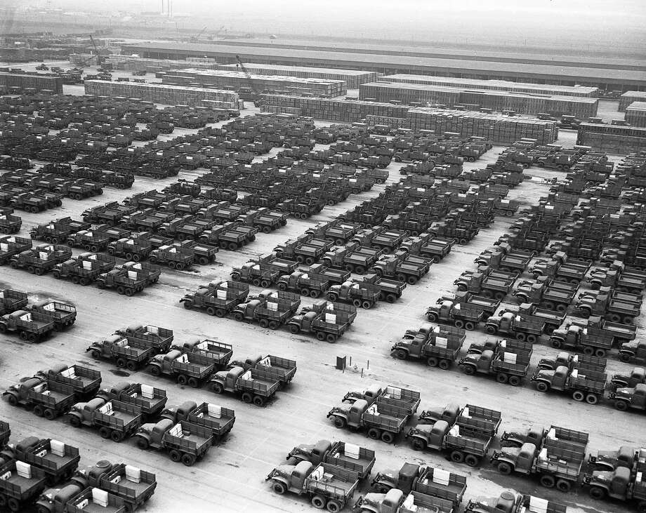 Rows and rows of vehicles, including trucks, jeeps and sedans, at the Army Depot in Stockton, November 15, 1945. Photo: Aaron Rubino, The Chronicle