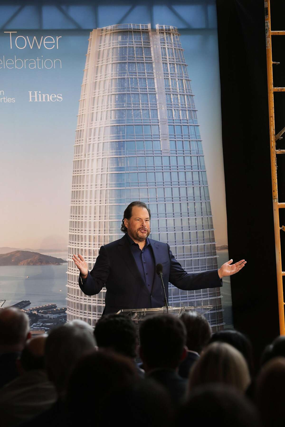 Marc Benioff, sCEO of Salesforce speaks to the gathering during a topping off ceremony as the final steel beam is being set to be moved into position on the Salesforce Tower in downtown San Francisco, Ca. on Thurs. April 6 2017.