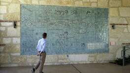 "Communications Administrator Konnor Frazier views the Bodine Gate tile mural, ""Acequia Madre Map"" inside the grounds at the Witte Museum on April 4. It shows the historic acequias from early San Antonio."