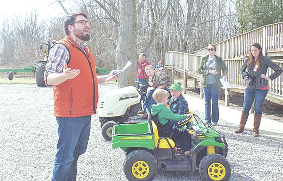 At right, Dustin Leipprandt, 10, drove a Cub Cadet lawn tractor while Massey Sherman, 4, and Noah Gokey, 5, each drove toy John Deere tractors. Photo: Mary Drier/For The Tribune / Copyright 2012