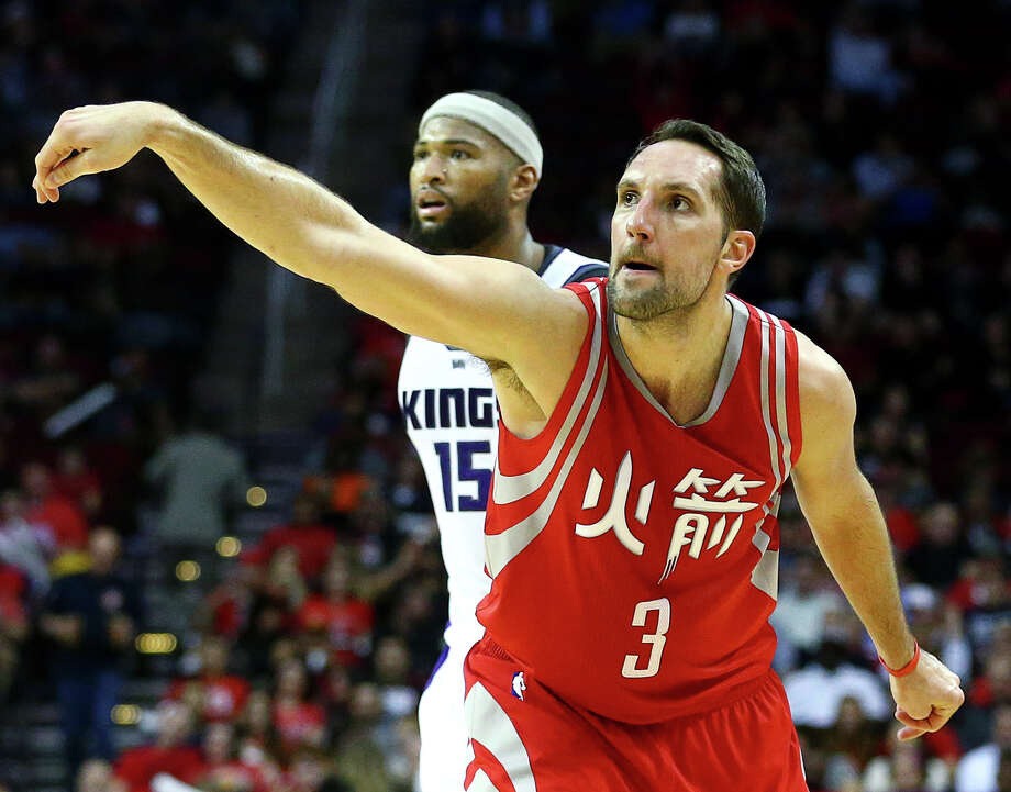 Houston Rockets forward Ryan Anderson (3) pauses to watch his three-point shot go in as Sacramento Kings forward DeMarcus Cousins (15) looks on during the third quarter of an NBA game at the Toyota Center, Tuesday, Jan. 31, 2017, in Houston. ( Jon Shapley / Houston Chronicle ) Photo: Jon Shapley, Staff / © 2017  Houston Chronicle