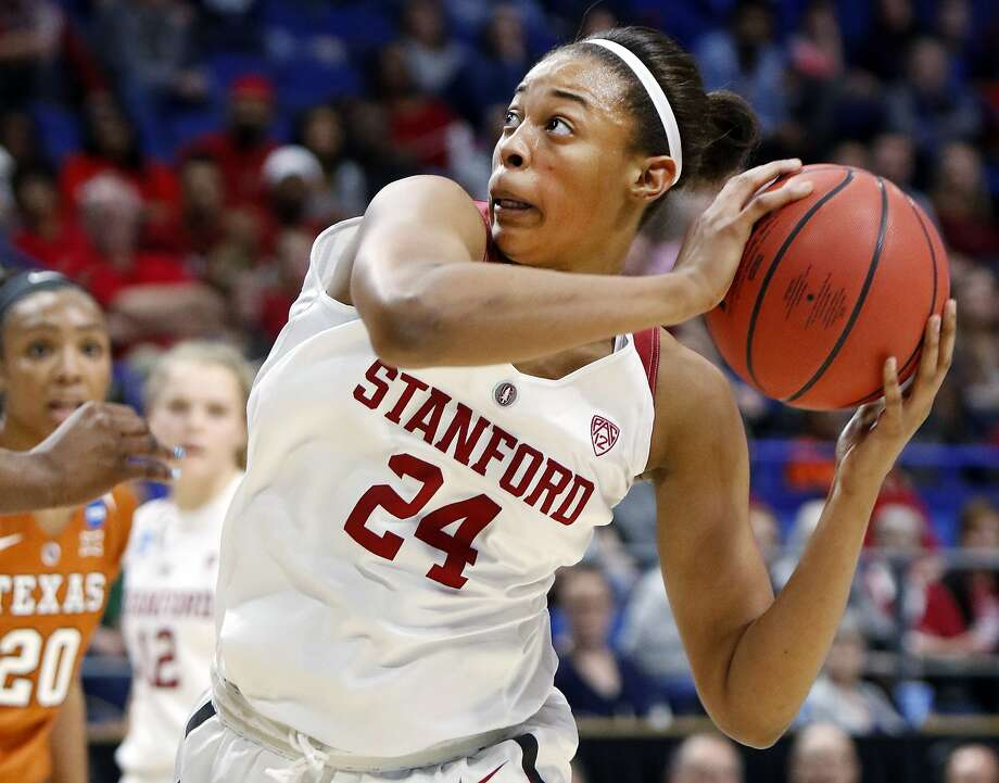 Stanford's Erica McCall (24) looks for an opening near the defense of Texas' Brianna Taylor (20) during a regional semifinal in the NCAA women's college basketball tournament in Lexington, Ky., Friday, March 24, 2017. Stanford won 77-66. (AP Photo/James Crisp) Photo: James Crisp, Associated Press