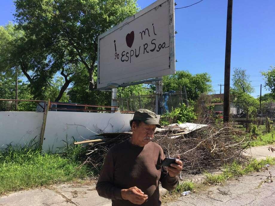 Igo Mendoza Gallegos is using a billboard behind his auto garage on Buena Vista Street, just west of downtown San Antonio, to promote his song about the Spurs in 2017 Photo: Roy Bragg / San Antonio Express-News
