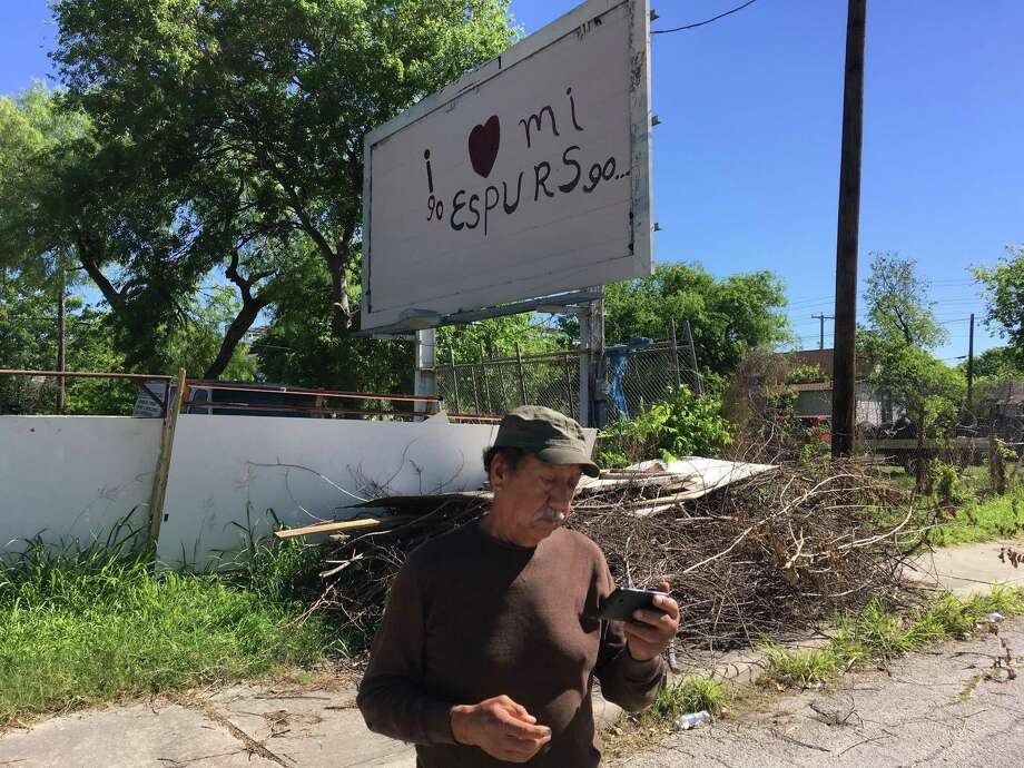 Igo Mendoza Gallegos is using a billboard behind his auto garage on Buena Vista Street, just west of downtown San Antonio, to promote his song about the Spurs in 2017 Photo: Roy Bragg / San Antonio Express-News