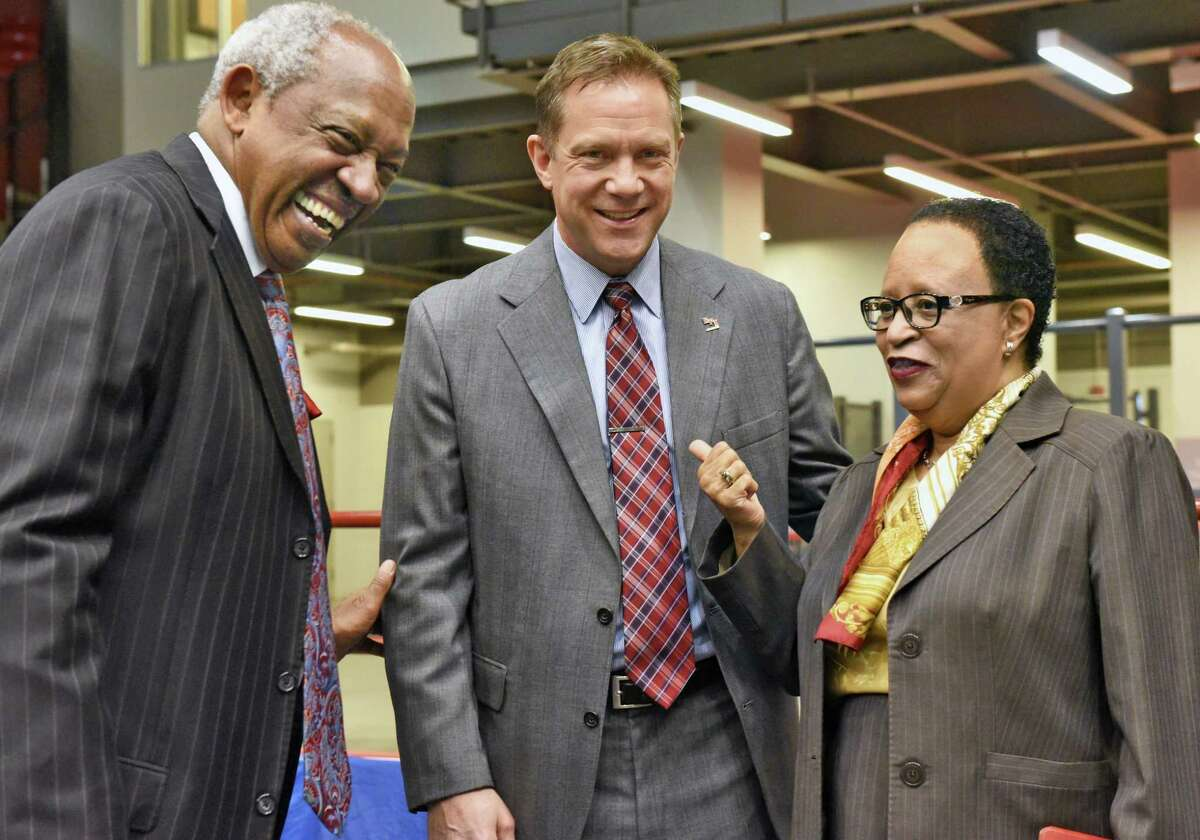 Director of athletics, Dr. Lee McElroy Jr., left, and RPI president Shirley Ann Jackson, right, welcome Dave Smith as RPI's new men's hockey coach during a news conference Thursday April 6, 2017 in Troy, NY. Smith has spent the past 12 seasons as head coach at Canisius College. (John Carl D'Annibale / Times Union)