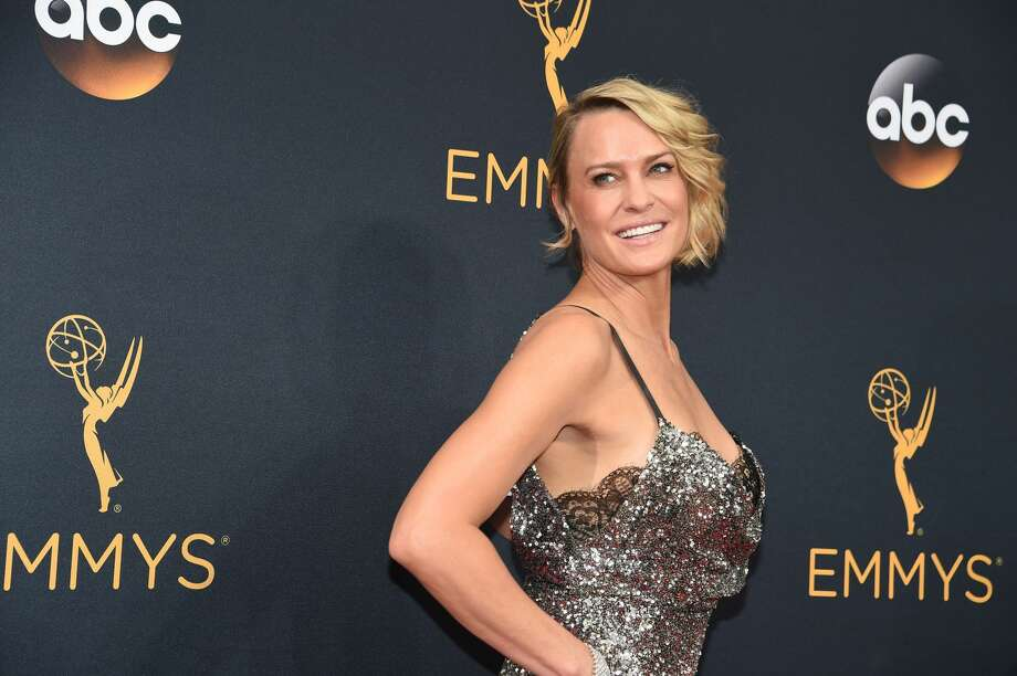 """Actress Robin Wright is 51 April 8, 2017, and the """"House of Cards"""" actress couldn't be aging better. Continue clicking to see the actress through the years. Photo: ROBYN BECK/AFP/Getty Images"""