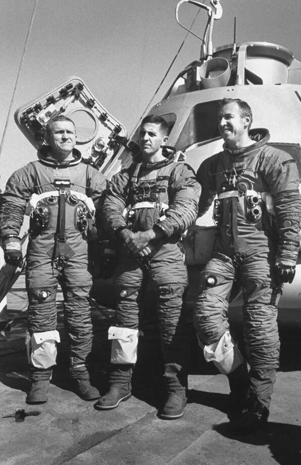 Federal prosecutors in Seattle claim a bookkeeper stole $755,400 from astronaut William Anders, pictured above at center. Apollo 8 astronauts Frank Borman, left, and James A Lovell Jr., right, are also pictured. Photo: Ralph Morse/The LIFE Picture Collection/Getty Images
