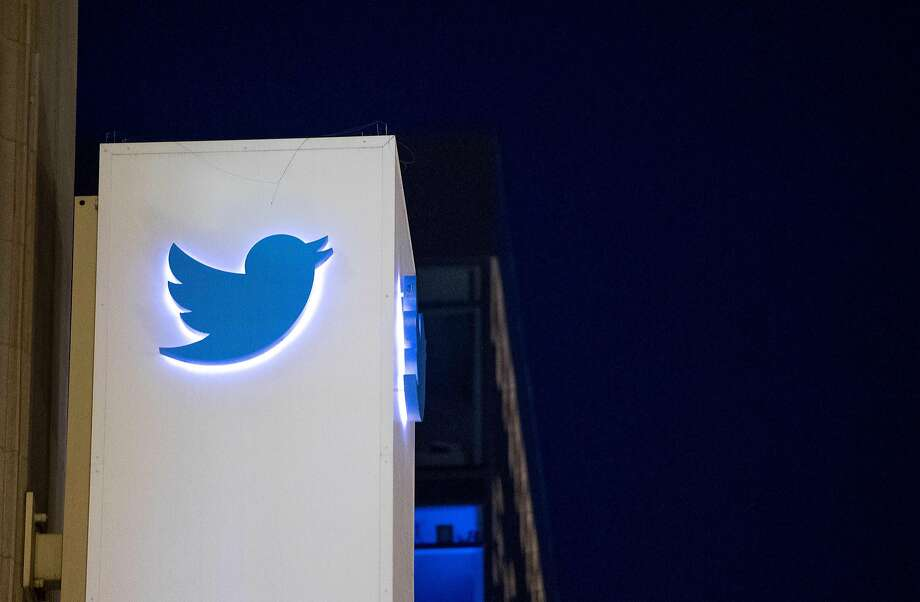 A sign at Twitter headquarters in San Francisco shows the company logo. in San Francisco, California. The company is suing the federal government to block the release of the identity of an account that has been critical of the Trump administration. Photo: JOSH EDELSON, AFP/Getty Images