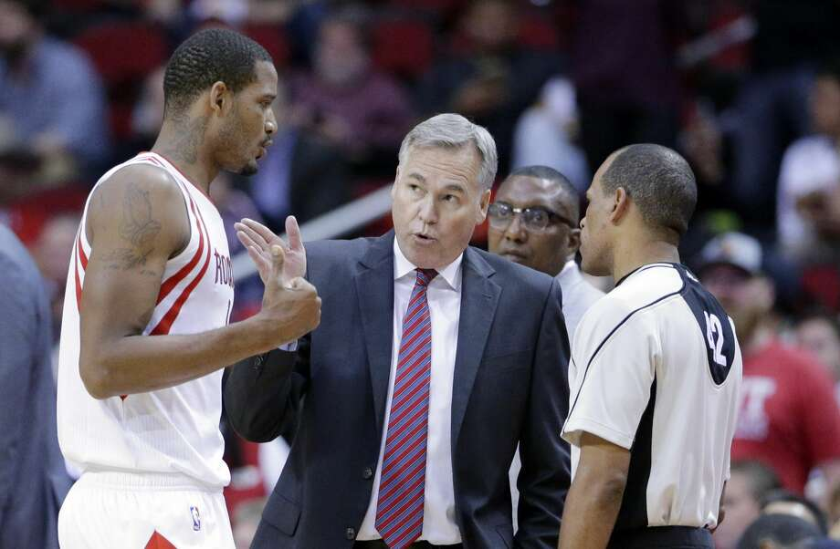 Houston Rockets' Trevor Ariza and head coach Mike D'Antoni argue a foul call against Ariza with official Eric Lewis in the second half of an NBA basketball game against the Denver Nuggets Wednesday, April 5, 2017, in Houston. (AP Photo/Michael Wyke) Photo: Michael Wyke/Associated Press