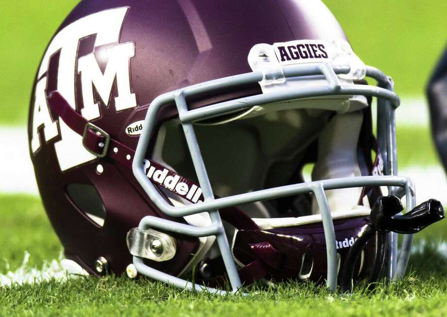 A Texas A&M helmet sits on the turf at Kyle Field in College Station. Photo: Juan DeLeon /Associated Press / FR171058 AP
