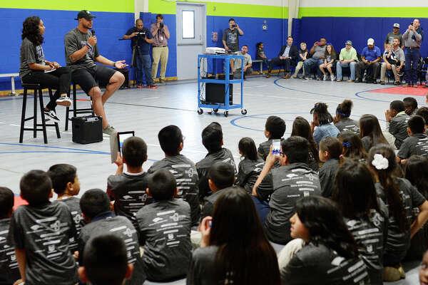 Dallas Cowboys quarterback Dak Prescott talks to children at the Midland Boys & Girls Club on April 6, 2017. James Durbin/Reporter-Telegram
