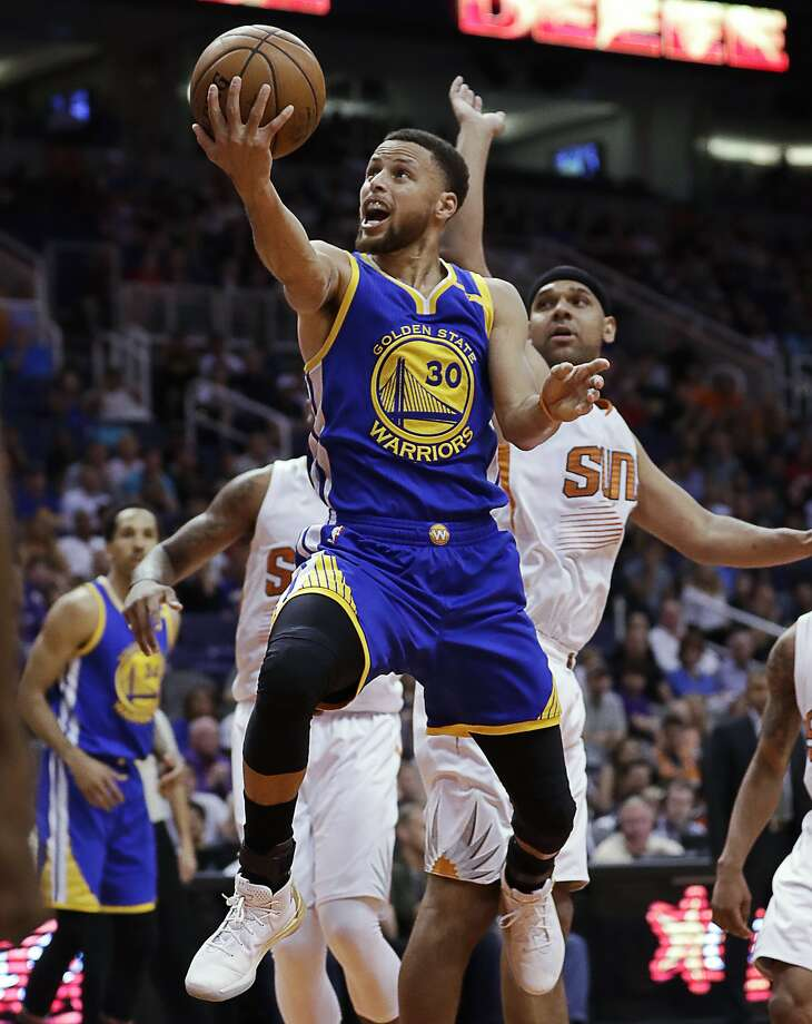 Golden State Warriors guard Stephen Curry (30) drives past Phoenix Suns forward Jared Dudley during the second half of an NBA basketball game, Wednesday, April 5, 2017, in Phoenix. (AP Photo/Matt York) Photo: Matt York, Associated Press