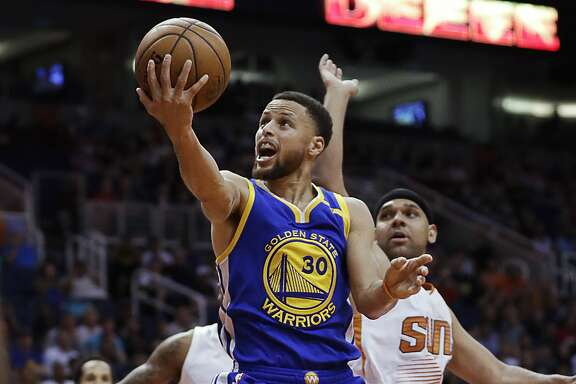 Golden State Warriors guard Stephen Curry (30) drives past Phoenix Suns forward Jared Dudley during the second half of an NBA basketball game, Wednesday, April 5, 2017, in Phoenix. (AP Photo/Matt York)