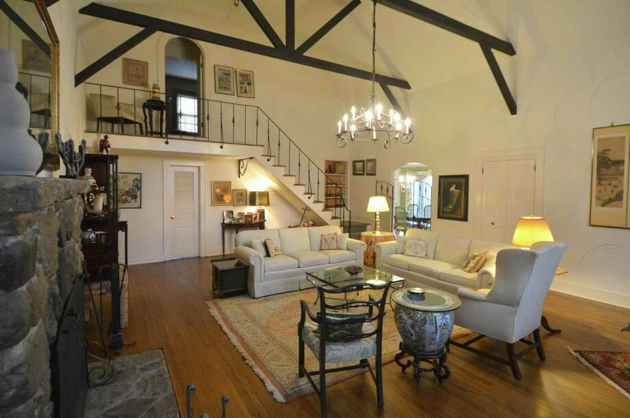 The interior of the property known as Cosywood featuring exposed beams, vaulted ceiling and ornate wrought iron. Photo: Alex Von Kleydorff / Hearst Connecticut Media / Norwalk Hour