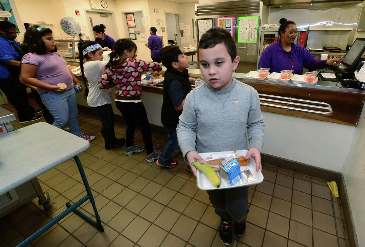Brookside Elementary School 3rd grader Juan Garcia picks up his lunch in the cafeteria Thursday, April 6, 2017, at the school in Norwalk, Conn. A report on Norwalk Public Schools?' food service operations found a need for widespread change, citing issues such as poor food quality, lackluster leadership, minimal scratch-made food and more.