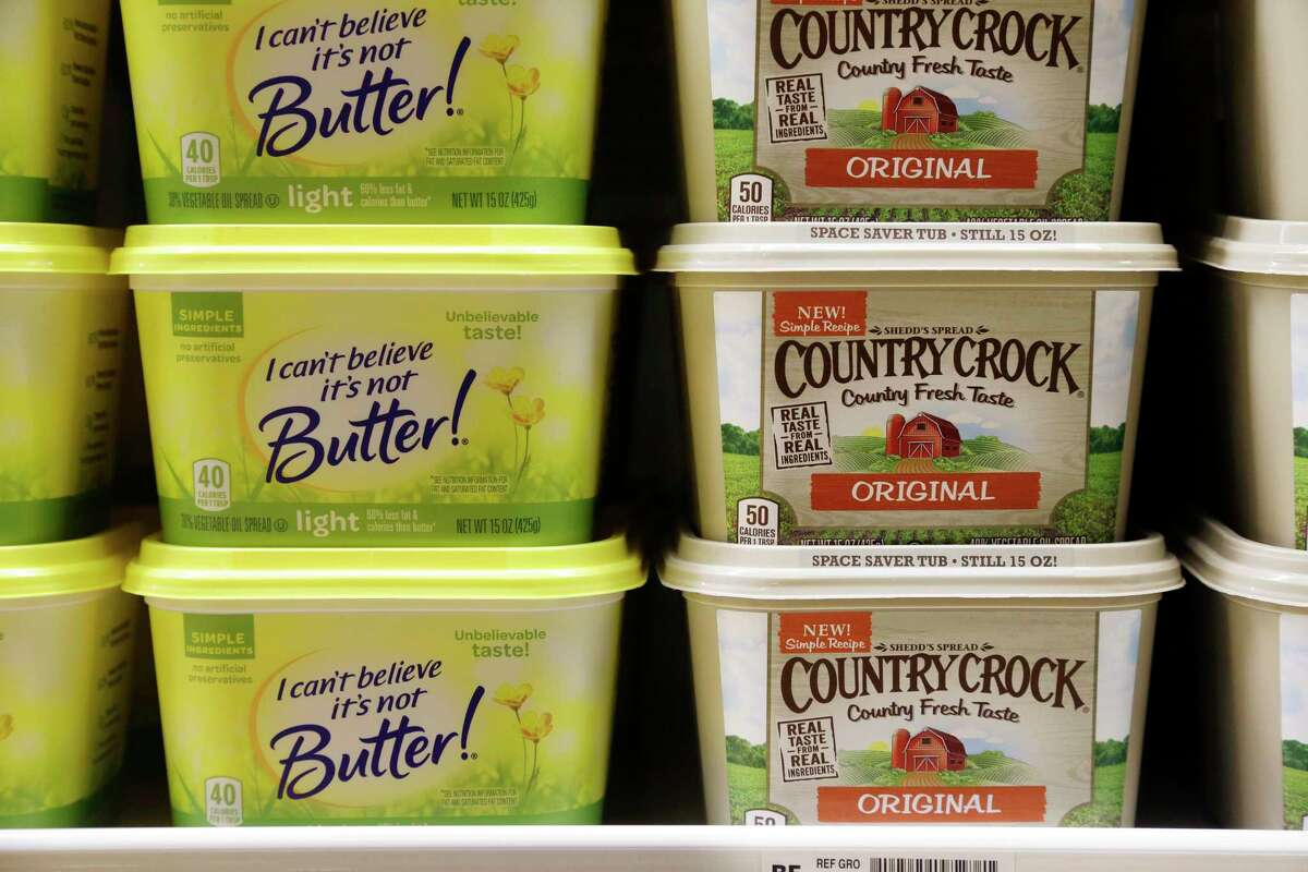 Containers of I Can't Believe It's Not Butter and Country Crock spreads sit in a grocery store cooler, Thursday, April 6, 2017, in Bellevue, Wash. Margarine's fortunes seem to be taking another sad turn, with the owner of the products looking for someone to take the brands off its hands. Consumer products heavyweight Unilever said it's seeking to unload its spreads business that has suffered from soft sales in the United States and other developed markets. (AP Photo/Elaine Thompson) ORG XMIT: WAET101