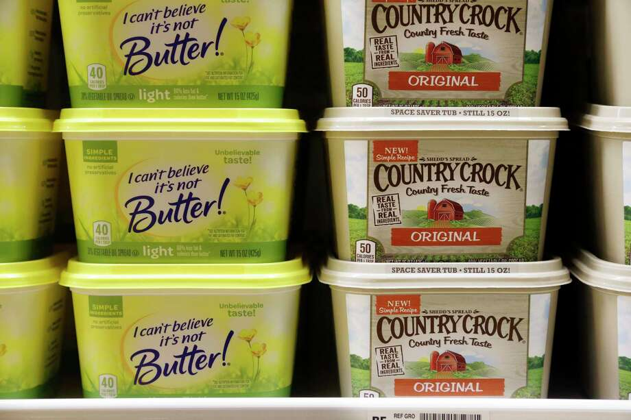 Containers of I Can't Believe It's Not Butter and Country Crock spreads sit in a grocery store cooler, Thursday, April 6, 2017, in Bellevue, Wash. Margarine's fortunes seem to be taking another sad turn, with the owner of the products looking for someone to take the brands off its hands. Consumer products heavyweight Unilever said it's seeking to unload its spreads business that has suffered from soft sales in the United States and other developed markets. (AP Photo/Elaine Thompson) ORG XMIT: WAET101 Photo: Elaine Thompson / Copyright 2017 The Associated Press. All rights reserved.