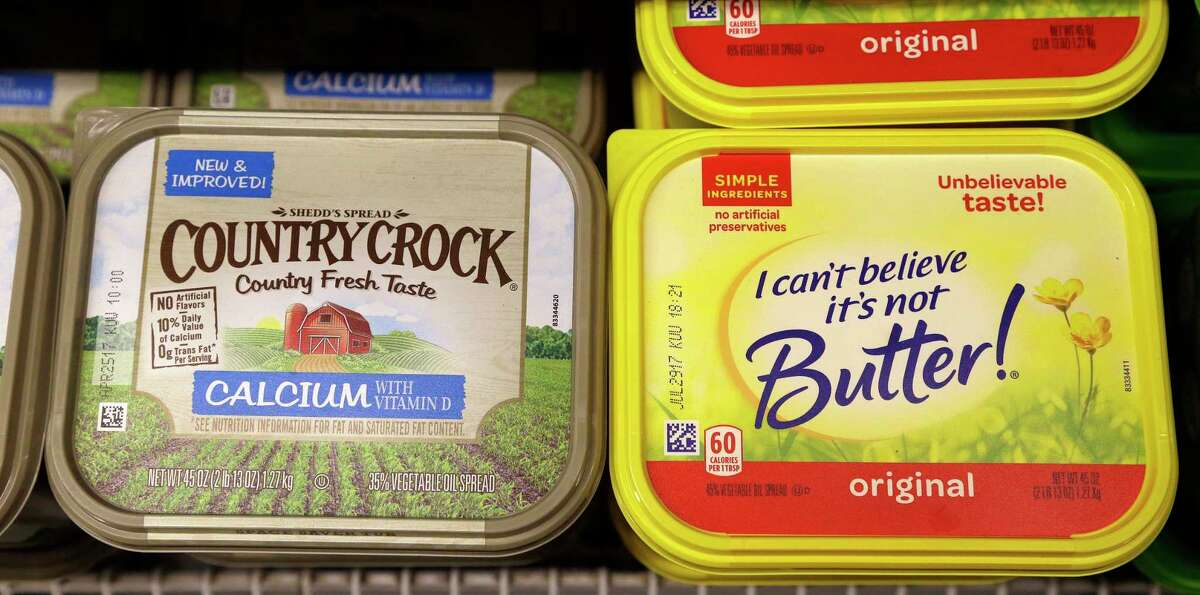 Containers of I Can't Believe It's Not Butter and Country Crock spreads sit in a grocery store cooler, Thursday, April 6, 2017, in Bellevue, Wash. Margarine's fortunes seem to be taking another sad turn, with the owner of the products looking for someone to take the brands off its hands. Consumer products heavyweight Unilever said it's seeking to unload its spreads business that has suffered from soft sales in the United States and other developed markets. (AP Photo/Elaine Thompson) ORG XMIT: WAET103